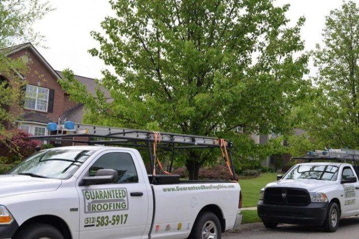 Guaranteed Roofing trucks