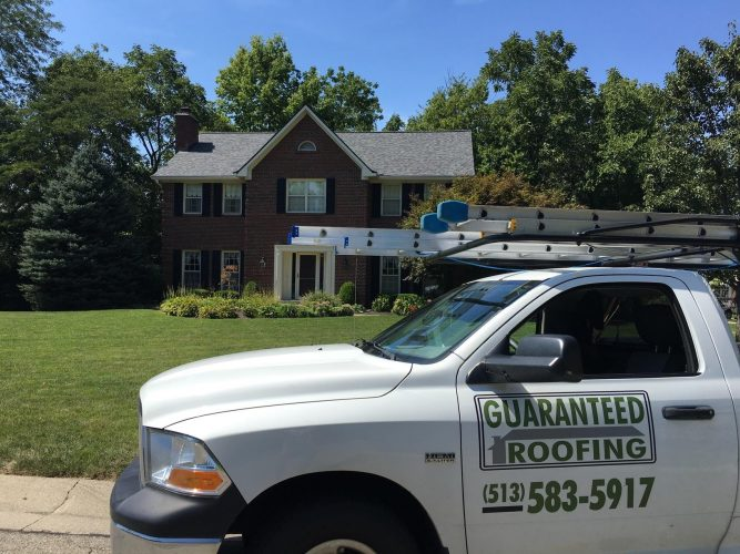 Guaranteed Roofing truck